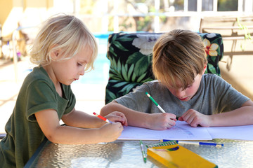 Two Little Kids Drawing on Paper Outside by Pool on Summer Day