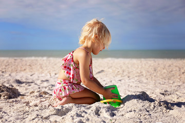 Little Toddler Kid Playing at Beach Building a Sand Castle