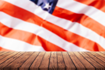 old wooden table for advertising goods on the background of the American flag, a template for the infographic of trade in the United States, a template for advertising goods from the United States,