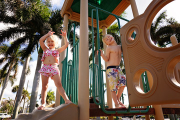 Happy Little Kids Playing on Playground at Beach