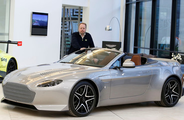 Andy Palmer, CEO of Aston Martin poses for a photograph at their world headquarters in Gaydon