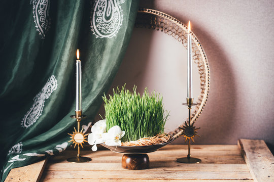 Novruz still life with semeni sabzi wheatgrass , silk national scarf, eastern musical instrument and orchids. Spring equinox in March celebration, copy space
