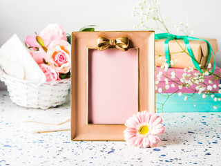 Pink frame with bow and flowers, gift box