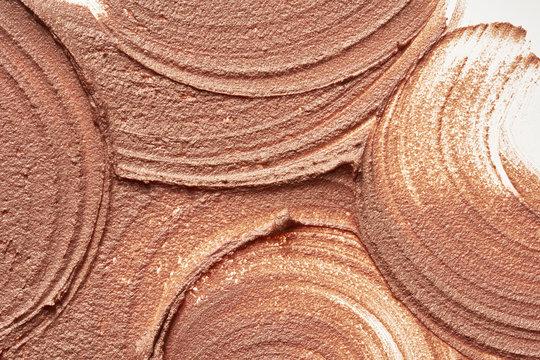 Light beige makeup smear of creamy foundation