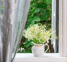 Printed roller blinds Lily of the valley a bouquet of lily-of-the-valley flowers on a windowsill in a country house in the spring morning