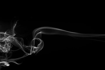 Movement of white smoke on black background