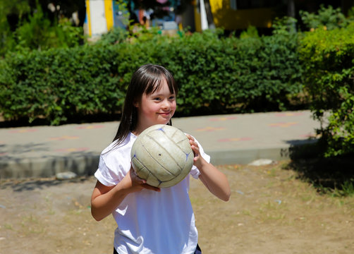 Little girl have fun with a ball