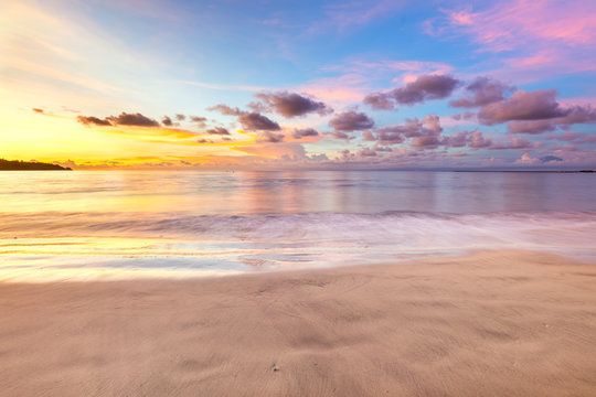 Gentle sunset above ocean, beautiful tropical clouds