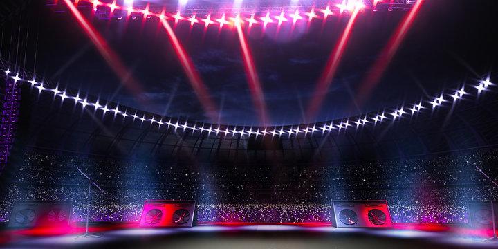 Empty main stage big music festival. Aroun full stadium of spectators. fans are holding flashlights.