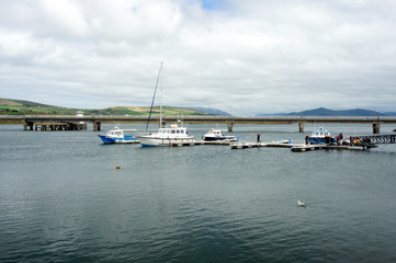 Boats against the backdrop of an automobile bridge to the Valentia Island.