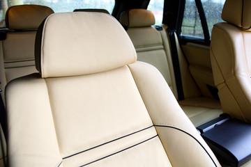 Luxury car inside. Interior of prestige modern car. Comfortable leather seats. Beige stitched leather cockpit