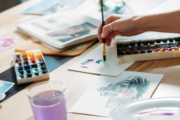 Artist inspiration. Creating watercolor artwork. Painter doing color mix brushstrokes.