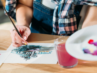 Watercolor painting. Artist at work. Painter doing color mix brushstrokes.