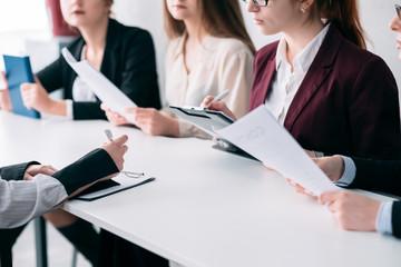 Recruitment team. Corporate job hiring. HR females examining applicant resume.