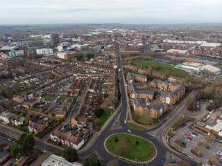 Aerial photo of the town of Aylesbury in the UK showing roads, residential properties, rows of houses and businesses.