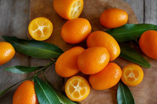 Kumquat fruits on a  wooden background
