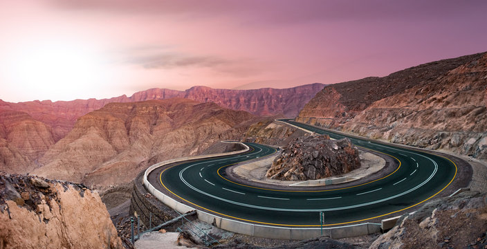 Serpentine Road in Pink Mountains on Sunset