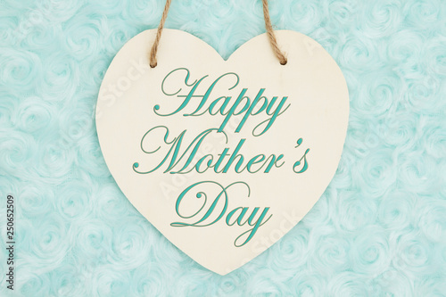 Happy Mother's Day message on wood heart shaped plaque with teal plush fabric