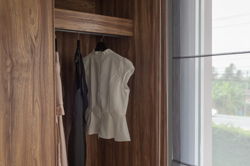 modern closet with clothes