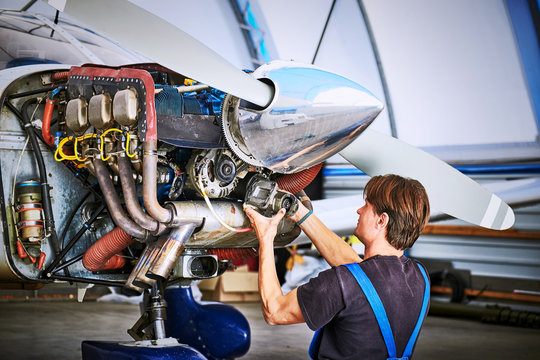 Replacing the defective parts of the aircraft service worker.