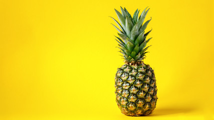 Pineapple on brightly yellow background. Minimal style. Food Idea .Summer concept.Copy space for Text.