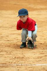 Cute boy playing tee ball or baseball