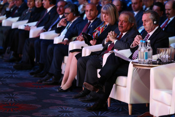 Britain's Secretary of State for International Trade Liam Fox listens to a translation at the Qatar UK Business and Investment Forum in London
