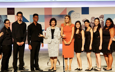 Queen Silvia of Sweden and Brazilian first lady Marcela Temer pose with choir youths at the end of the Global Child Forum at the Sao Paulo Industry Federation in Sao Paulo