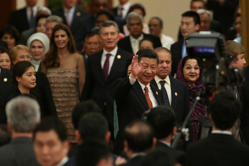 Chinese President Xi waves to guests at welcome banquet for the Belt and Road Forum at the Great Hall of the People in Beijing