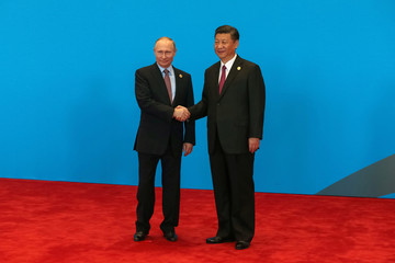 Chinese President Xi Jinping shake hands with Russian President Vladimir Putin as they attend the welcome ceremony at Yanqi Lake during the Belt and Road Forum, in Beijing