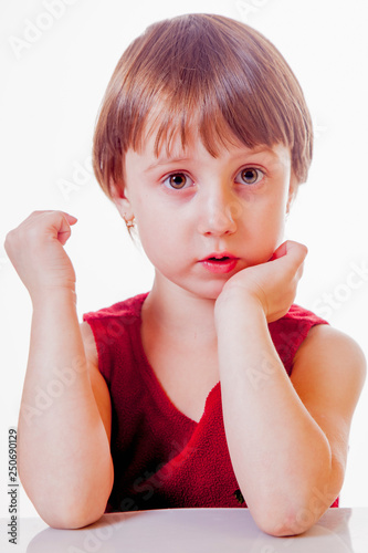 Portrait of surprised little cute child girl with wide open eyes and