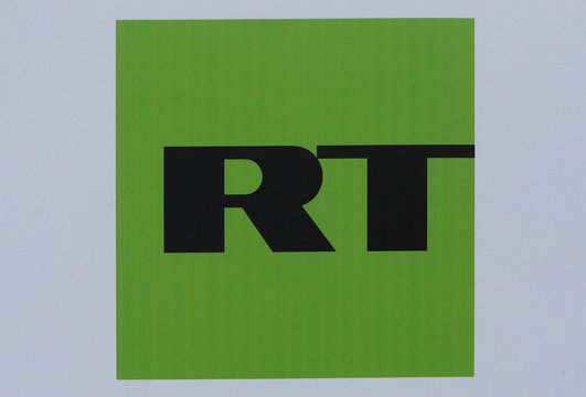 The logo of Russian television network RT is seen on a board at the SPIEF 2017 in St. Petersburg