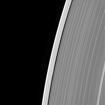 Saturn's outer A ring features the small moon Daphnis and the waves it raises in the edges of the Keeler Gap
