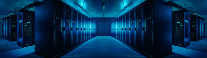 Wide-Angle Panorama Shot of a Working Data Center With Rows of Rack Servers. Blue Led Lights Blinking and Computers are Working. Dark Ambient Light.