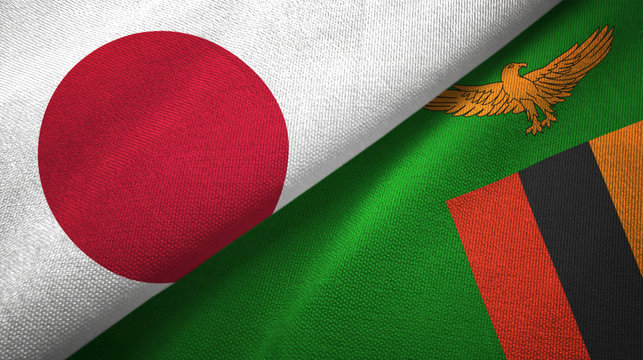 Japan and Zambia two flags textile cloth, fabric texture