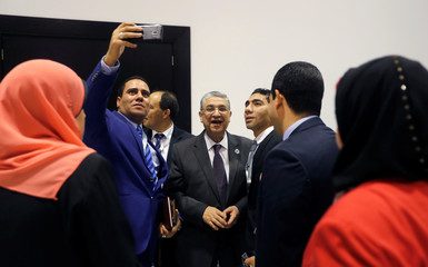 A member of the media takes a selfie picture with Egypt's Electricity Minister Mohamed Shaker at Africa 2018 Forum in the Red Sea resort of Sharm el-Sheikh
