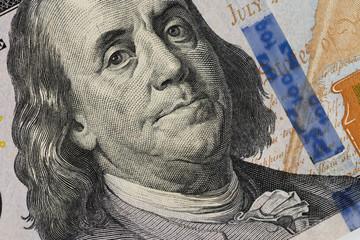 Closeup photo of a 100 dollar bill.