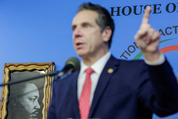 A picture of Martin Luther King Jr. is seen on the wall as New York Gov. Cuomo speaks to guests during the National Action Network  Dr. Martin Luther King, Jr. Day Public Policy Forum in the Harlem borough of New York City