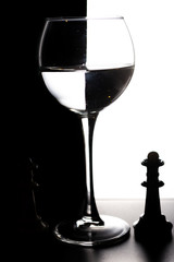 Glass of water with overlap in the form of a chessboard concept
