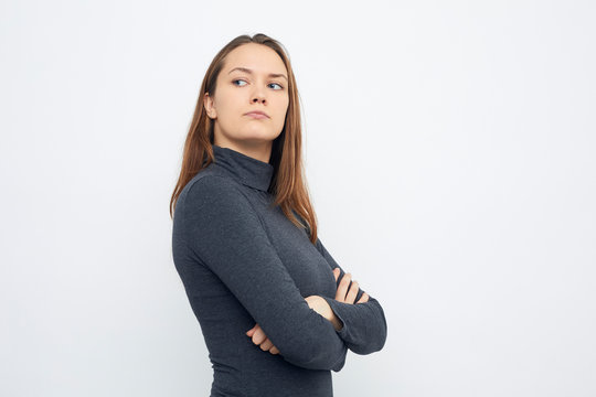 portrait of young woman looking mad over shoulder