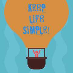 Conceptual hand writing showing Keep Life Simple. Business photo text invitation anyone not complexing things or matters Hu analysis Dummy Arms Raising inside Gondola Riding Air Balloon