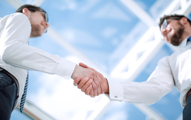 bottom view.background image of a handshake of business people