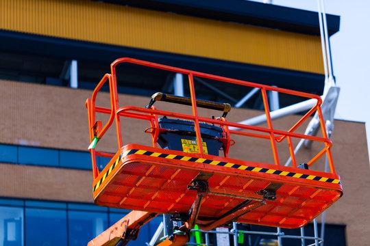 Elevating crane basket for engeneer. Industry concept with construction site elevating crane