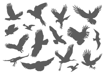 Silhouette of flying birds on white background. Inspirational body flash tattoo ink. Set with textured stipple grey birds fly swallows hand made. Vector.