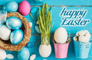 Bright blue colored Easter eggs in nest on wooden background, selective focus image. Happy Easter card