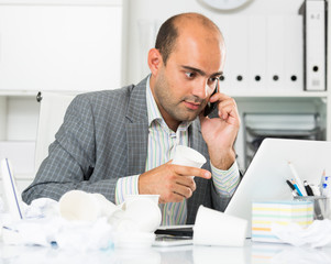 man office worker deciding and talking on the phone