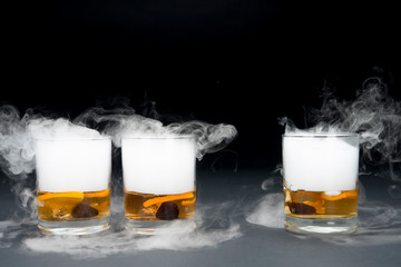 glass of beer on a black background