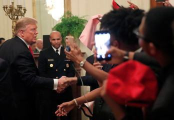 U.S. President Donald Trump greets attendees at the National African American History Month Reception at the White House in Washington