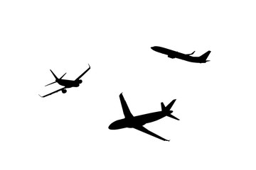 An airplane silhouette cropped on a neutral background