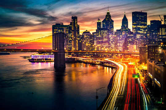 Must see when visiting New York City. View of Lower Manhattan and  Brooklyn at sunset. Night scene. Light trails. City lights. Urban living, travel, real estate  and transportation concept